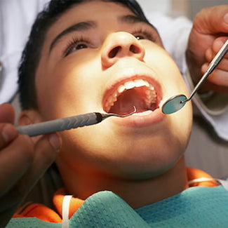 A patient being examined at Nashville Dentistry Co., a family dentist in Brentwood, TN