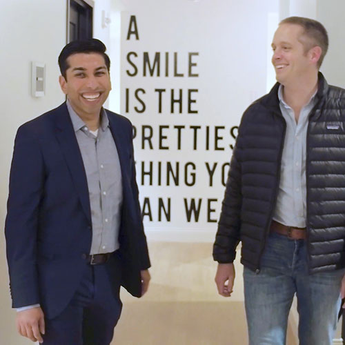 Dr. Patel laughing with a patient who lives in Tennessee