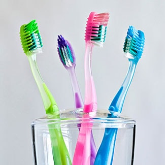 A cup of toothbrushes to represent oral hygiene which is offered as part of our family dentistry in Brentwood, TN
