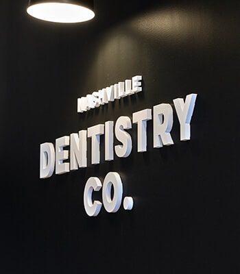 A close up of the logo for Nashville Dentistry, Co - a Brentwood dentist office
