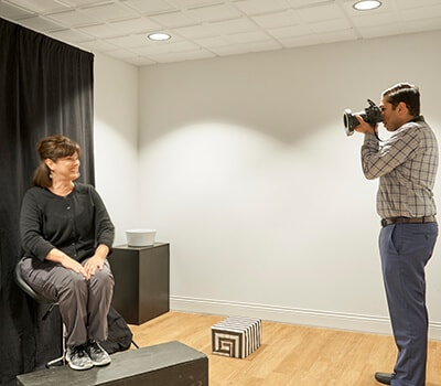 Dr. Patel, a Brentwood TN dentist, taking a photo of one of his cosmetic dentistry patients.