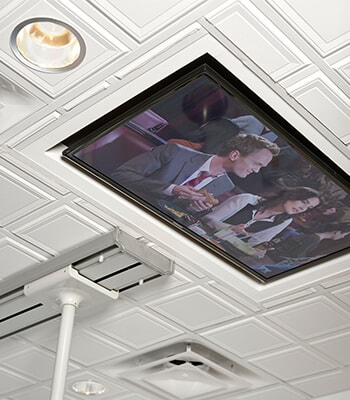 A ceiling TV to show the comforts offered by this Brentwood, TN dentist